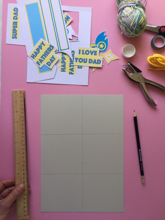 cut an A4 piece of card into six evenly sized bunting flag panels