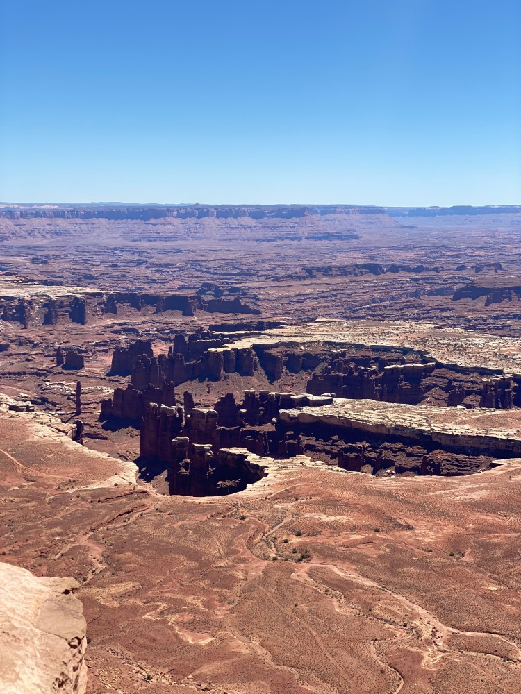 A view overlooking Canyonlands National Park needles and canyons from Grand View Point in the Island in the Sky District