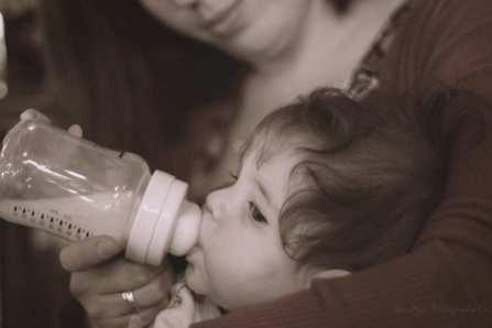 man person woman love portrait romance child bottle baby motherhood feeding nose candid mother infant toddler eye head skin sony emotion a700 paintthemoon interaction sadie 1852 human action