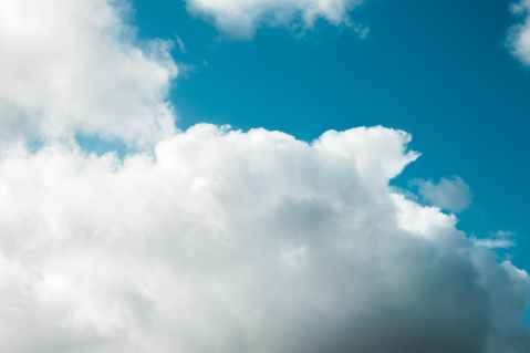 fluffy white clouds floating on blue sky