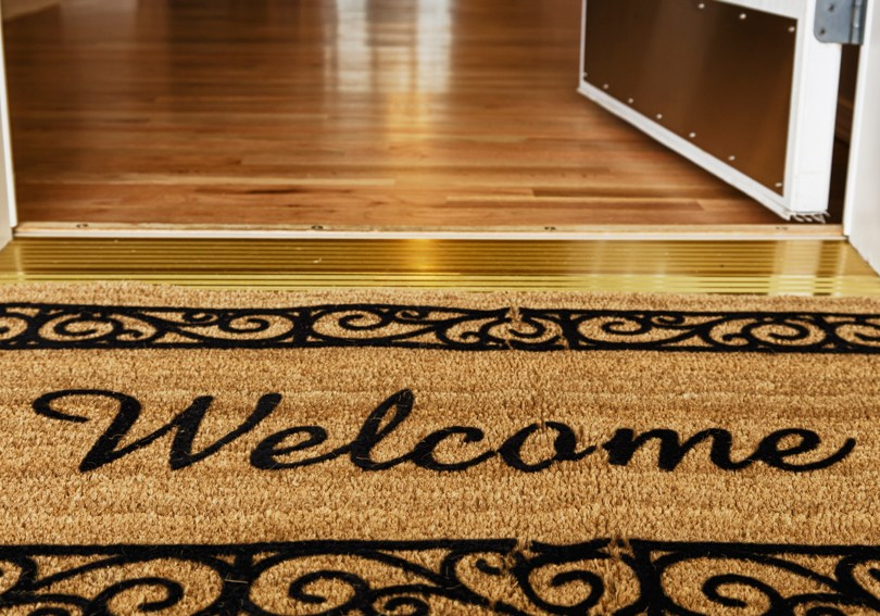A welcome mat in front of a door