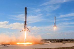 Falcon Heavy sider boosters landing