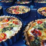 A selection of tomato and pesto quiches