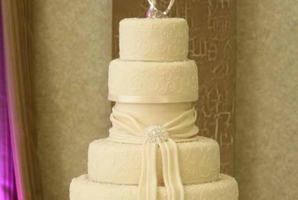 Five Tier White Ribbon Wedding Cake with a Heart Cake Topper