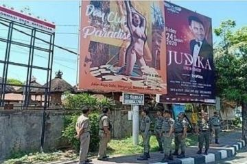 A Large Billboard on Jalan Raya Batubulan Removed For Picturing Girl In Bikini