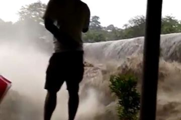 raging river in bali flooding