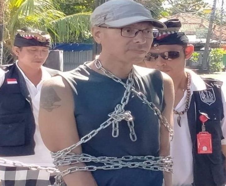 man chained on nyepi