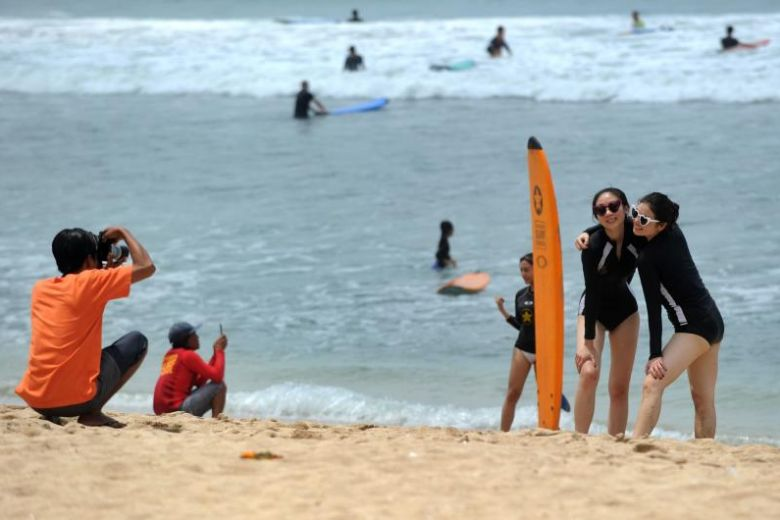 surfer tourists in bali