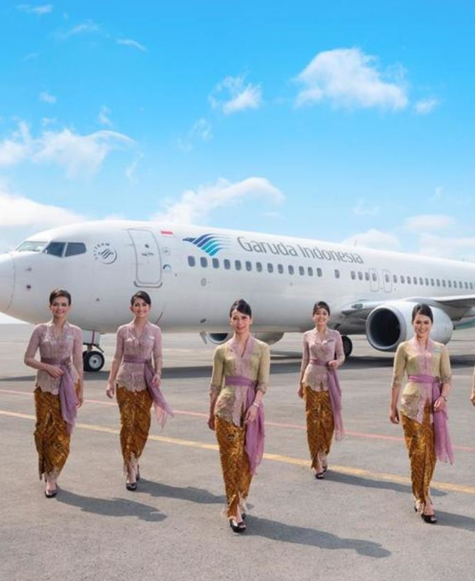 Garuda airlines flight crew walking outside of plane