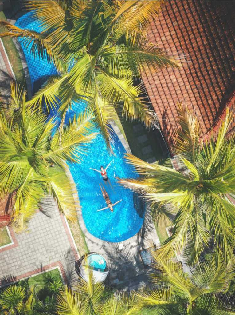 Women in bali villa pool