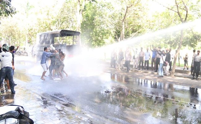 Police Use Water Cannon To Disperse Protesters In Bali