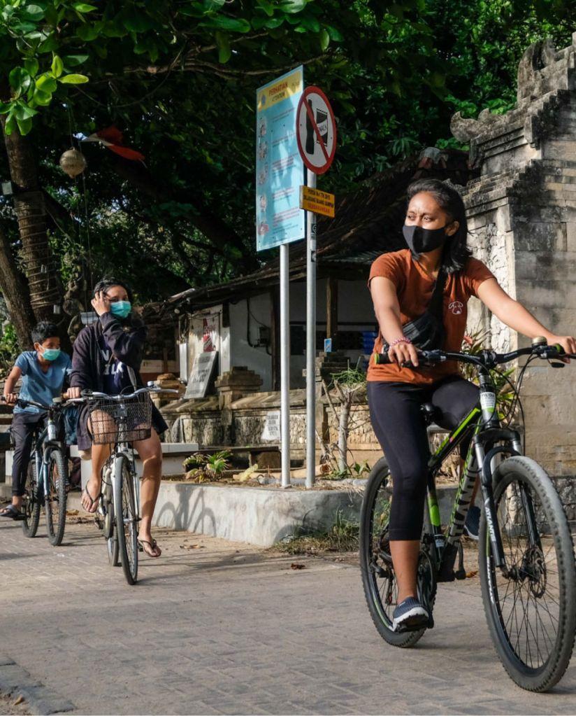 Bali locals on bikes wearing masks