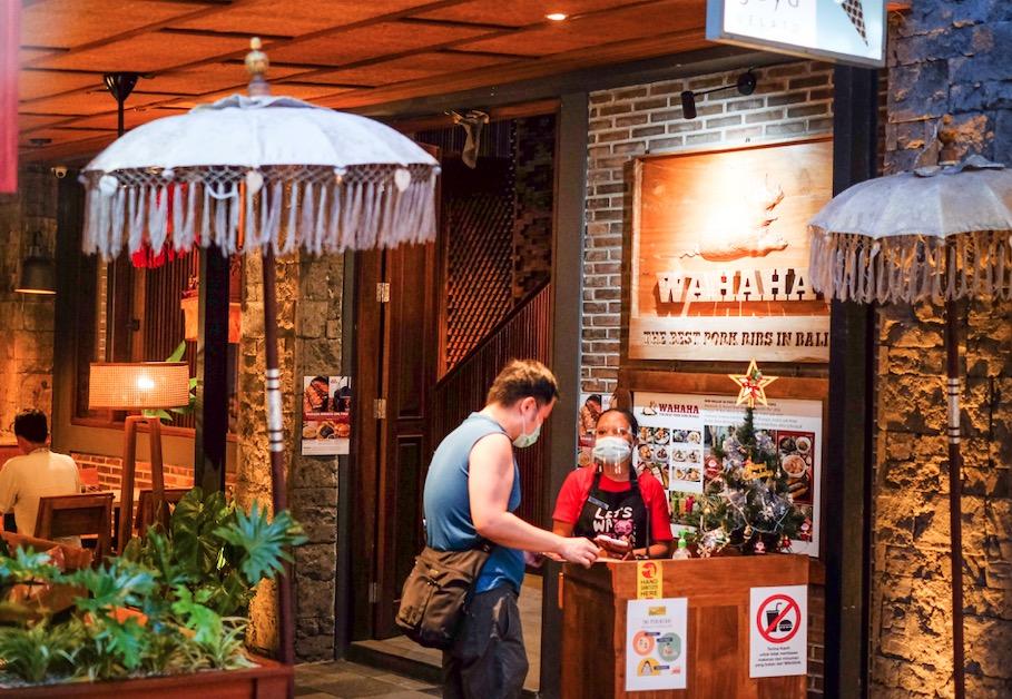 Restaurant staff in masks Covid safety protocols Bali