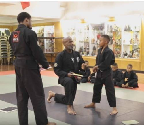 Martial-arts-teacher-consoles-tearful-black-boy-video-Optimized