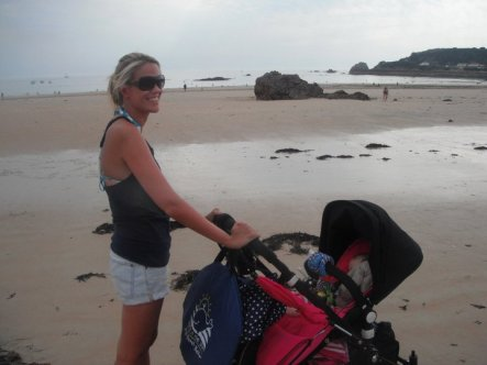 New mother with all the beach gear!