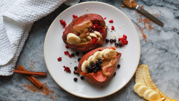 Easy breakfast stuffed sweet potatoes with banana, berries, and nut butter for a Whole30 compliant, Paleo, and Vegan start to your day!