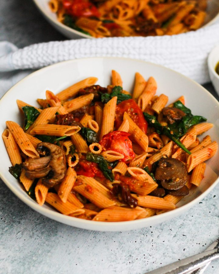 This vegan sun-dried tomato pesto pasta is incredibly easy to make for a week-night meal or meal prep ahead! It packs in loads of flavor and protein for a well-rounded meal!
