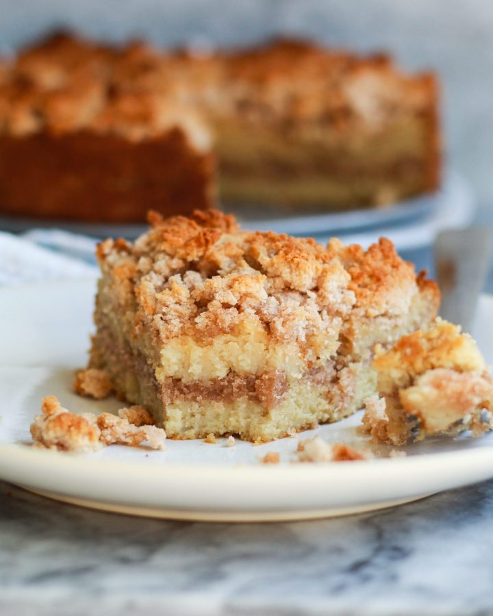 slice of paleo cinnamon coffee cake with a bite in it