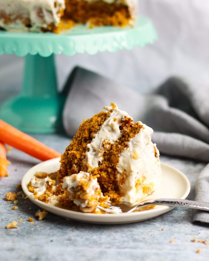 slice of carrot cake with fork in it