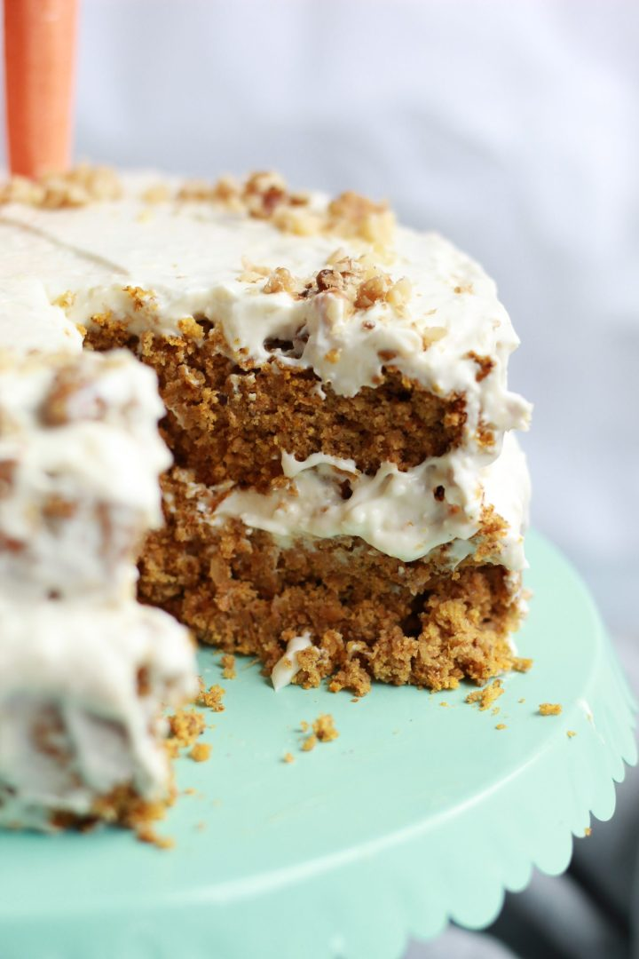 close up of vegan carrot cake missing slice