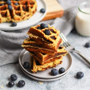 over head of paleo sweet potato waffles spread stacked