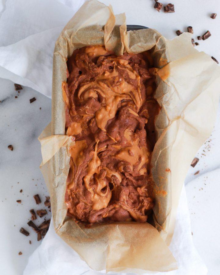swirl of peanut butter in chocolate nice cream