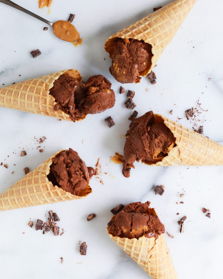 ice cream cones filled with dairy free chocolate peanut butter ice cream on marble slab