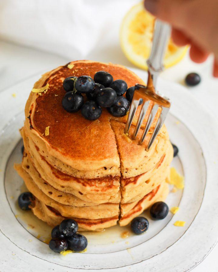fork taking bite out of lemon pancakes
