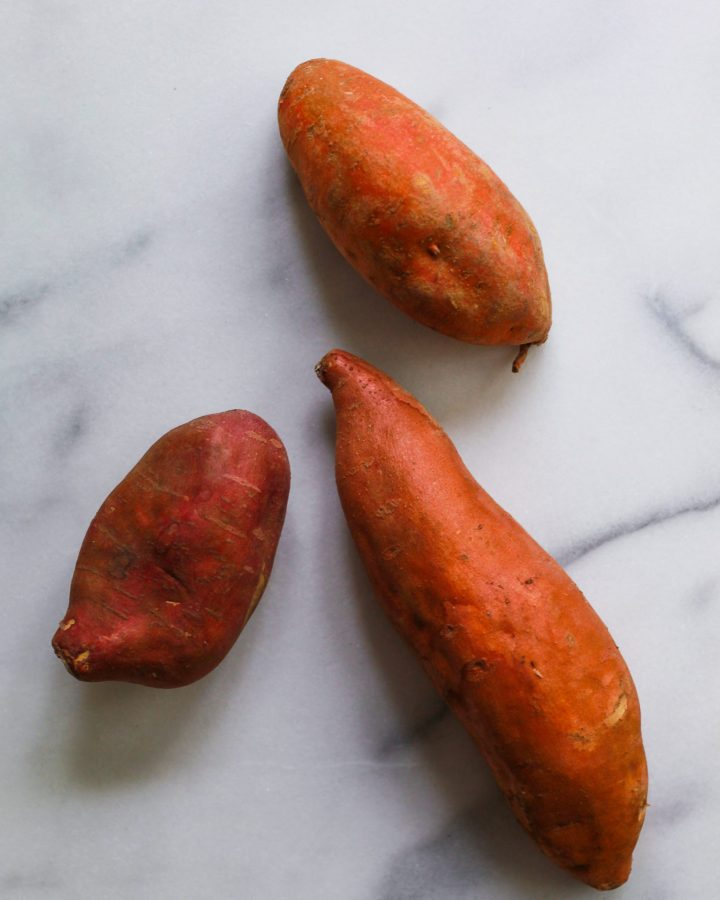 3 sweet potatoes on a marble slab