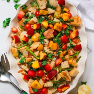 Panzanella salad with peaches and tomatoes