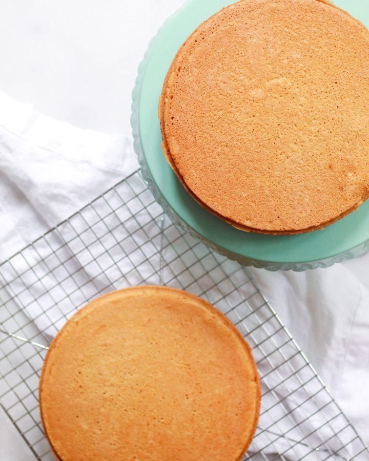 vegan vanilla cake tiers on cooling rack