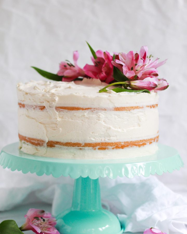 two tiered vanilla cake with flowers