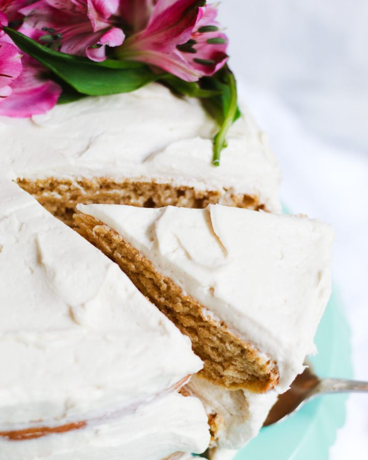 pulling out a slice of vegan vanilla cake