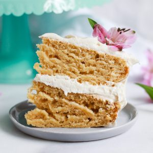 slice of two tiered vanilla cake