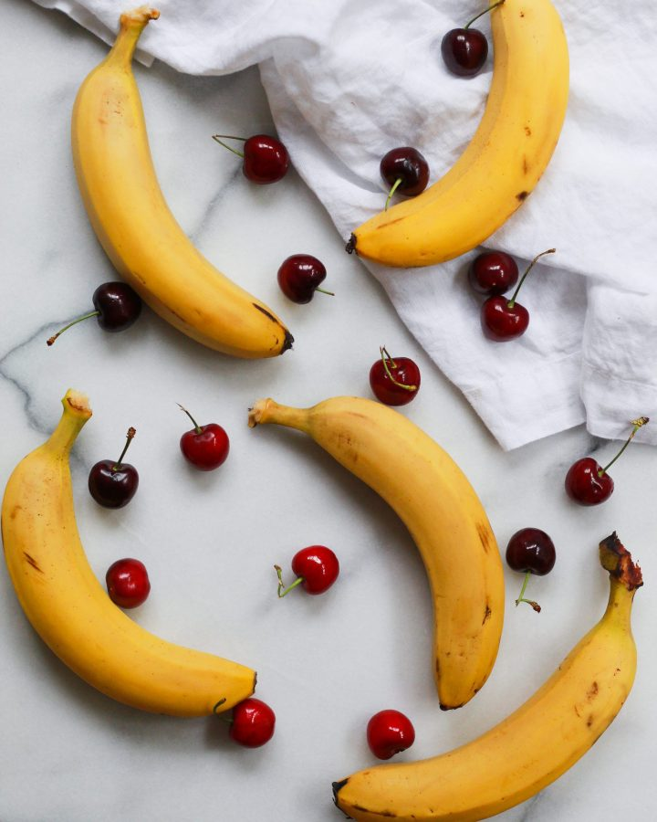 bananas and cherry on marble slab