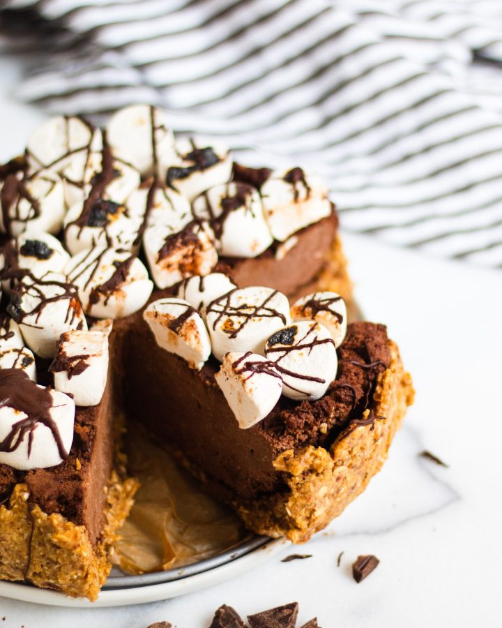 slice of s'mores pie in full pie