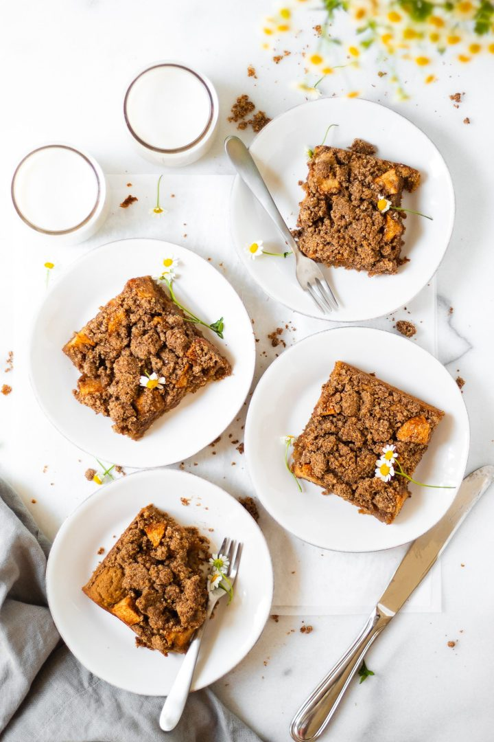 gluten free apple cake on white plates with forks