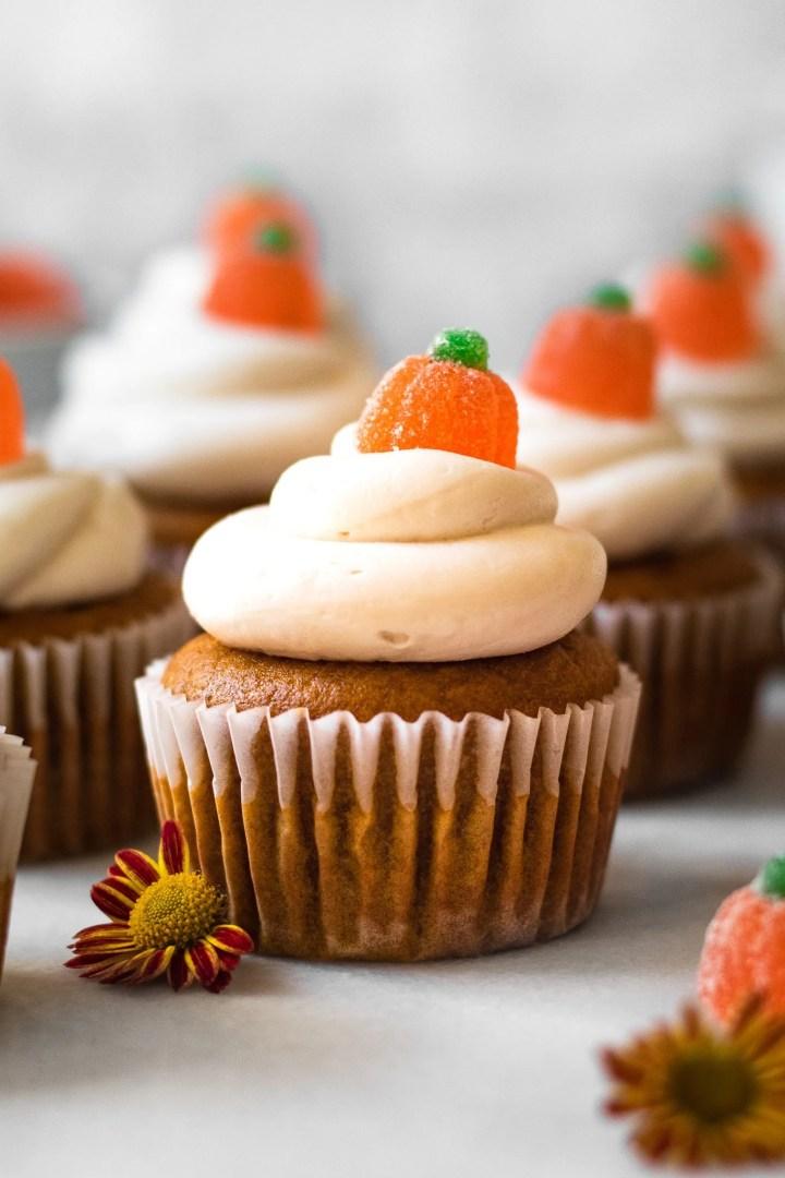 pumpkin cupcakes on marble slab