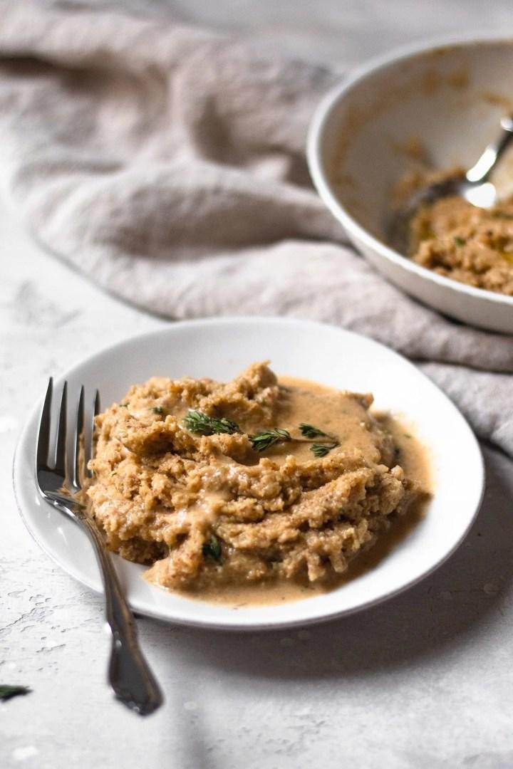 plate of cauliflower mash with vegan gravy