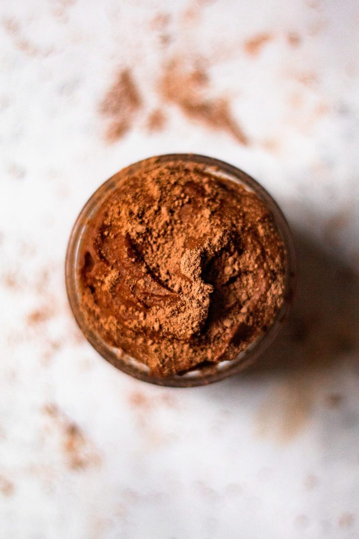 overhead of healthy chocolate mouse dusted with cacao
