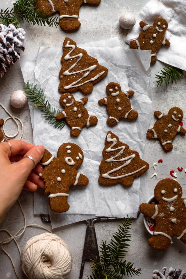 hand picking up gingerbread cookies
