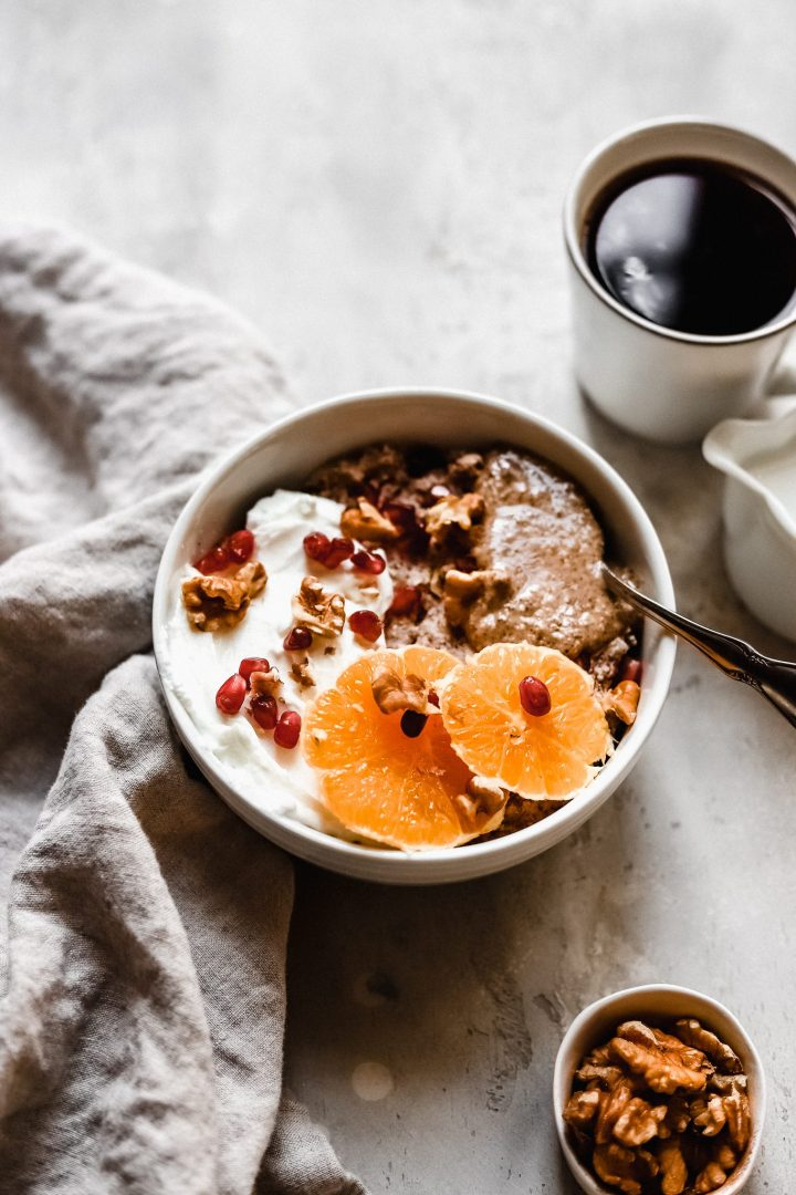 bowl of grain free hot cereal with cup of coffee