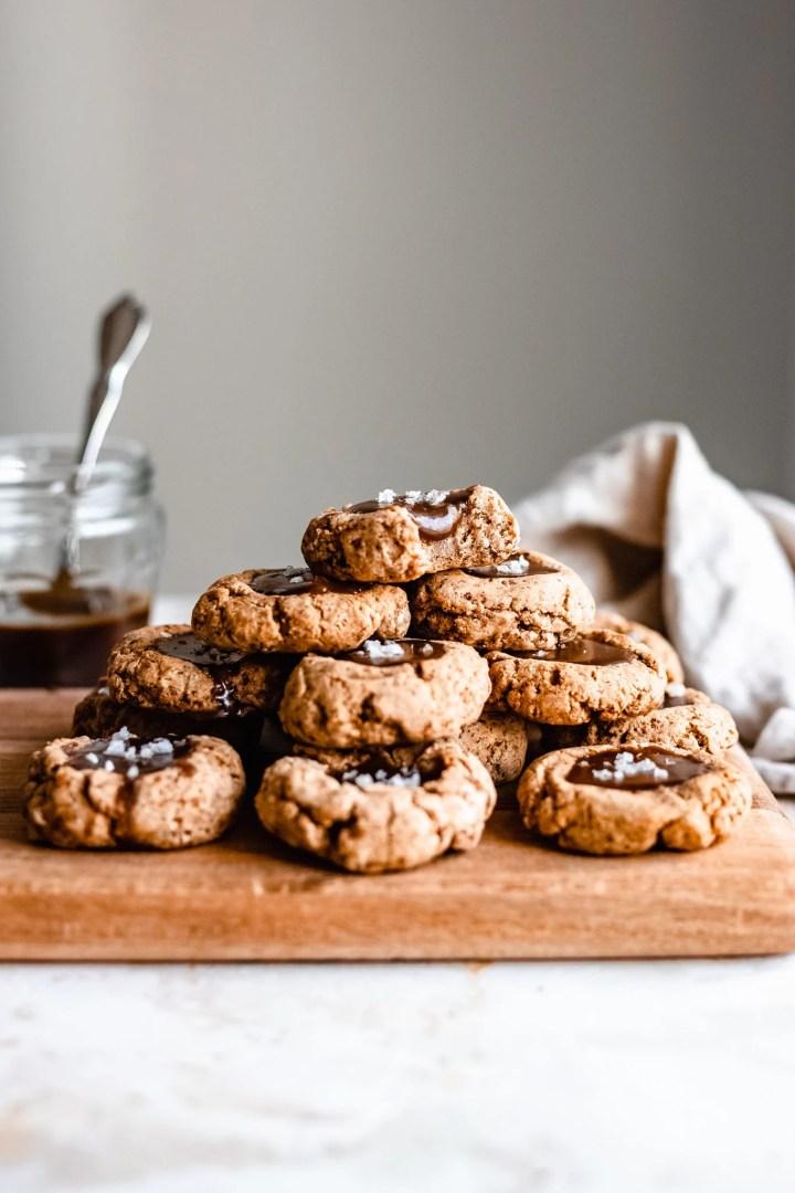 stack of caramel thumbprint cookies