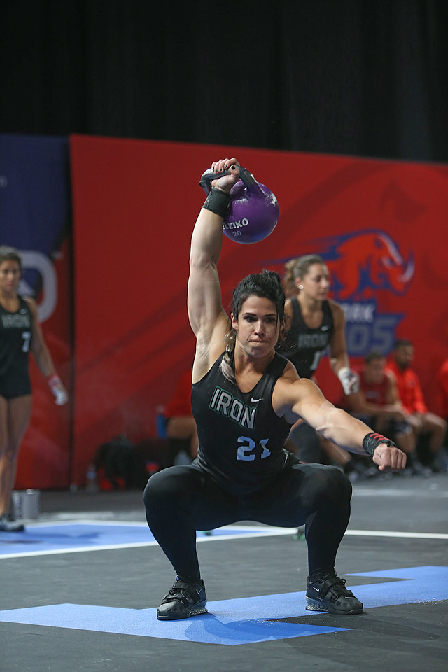 Britt Ringstrom repping out kettlebell overhead squats