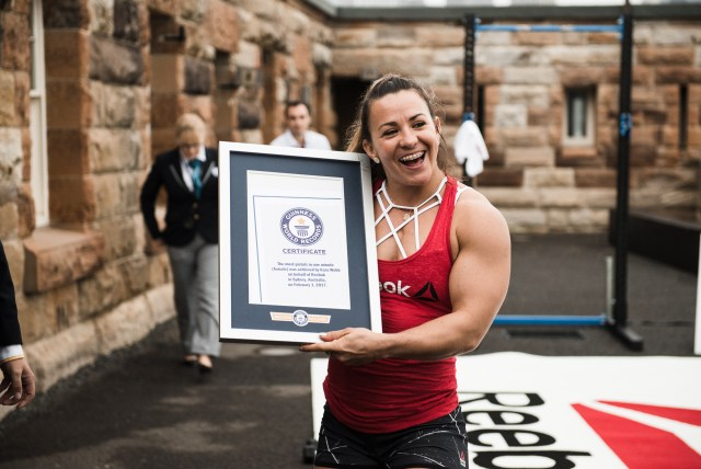 Kara Webb poses with her certificate after breaking the Guinness World Record for most pistols in one minute, female