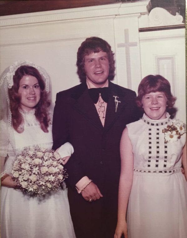 the bride, the groom, a young girl