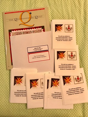 a magazine and quilt labels from The International Festival of Quilts