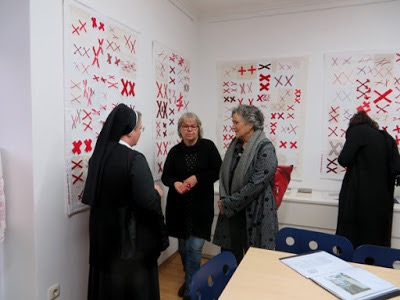 two nuns and two other women chat about the quilts made for The 70273 Project