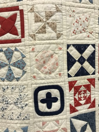 a closeup of small quilts sewn together to make a large quilt
