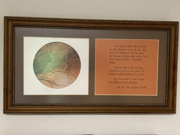 wedding invitation in frame